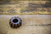 Old machine parts in machinery shop on wooden background.old machine with vintage picture style. — Stock Photo