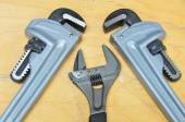 Set of hand tools on a wooden background, Wrench tools or Pipe wrench for hard work. — Stock Photo