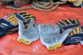 Old or dirty safety gloves on the works. — Stock Photo