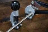 Tube bender or pipe bender tools on wooden background. — Stockfoto