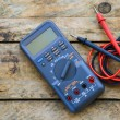 Close-up of digital multimeter on wooden background, Worker used electronic tools for checked circuit, Special tools on electronic job. — Stock Photo #74070151