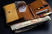 Banknotes of different countries in the wallet — Stock Photo