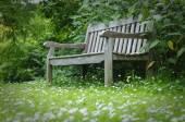 Wooden garden bench — Stock Photo