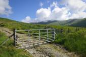 Mountain farm gate — Stock Photo