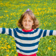 Child on the lawn with dandelions — Stock Photo #62603115