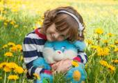 Little girl with a toy — Stock Photo