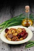 New roasted baked potatoe in the bowl — Stock Photo