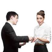 Businessman give money to surprised businesswoman — Stock Photo
