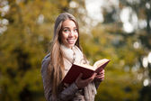 Female student holding book — Stock Photo