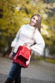 Attractive young woman holding shopping bags — Stock Photo