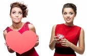 Two young cheerful women in red dress — Stock Photo