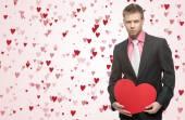 Handsome men hold big red heart — Stock fotografie