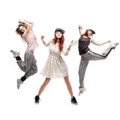 Group of young femanle hip hop dancers on white background — Stock Photo