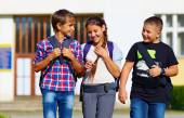 Schoolchildren, friends walking from school, fellow sympathy — Stock Photo