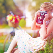 Woman with camera relaxing after bicycle ride — Stock Photo #52632843