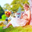 Woman after bicycle ride relaxing with camera — Stock Photo #52632859