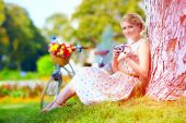 Woman after bicycle ride relaxing with camera — Stock Photo