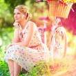 Elegant lady relaxing after bicycle ride — Stock Photo #52773921