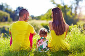 Happy family on summer field — Stock Photo