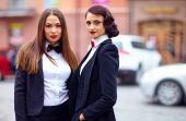 Beautiful girls in black suits — Foto Stock