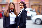 Beautiful girls in black suits — Zdjęcie stockowe