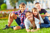 Happy schoolkids playing in the park — Stock Photo