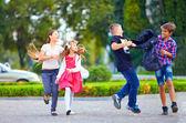 Friends, boys fight on schoolyard — Stock Photo