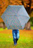 Boy hiding himself behind the umbrella — Stock Photo