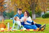 Happy family drinking warm tea on autumn picnic — Stock Photo