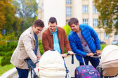 Happy fathers on parental leave, walking in city park — Stock Photo