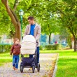 Father with kids walking in city park — Stok fotoğraf #55065547