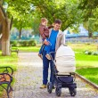 Father with kids walking in city park — Stok fotoğraf #55065559