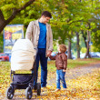 Father with kids walking in city park — Stockfoto #55065583