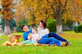 Happy family enjoying autumn picnic — Stock Photo