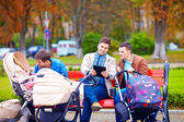 Young fathers with baby strollers on city walk — Stock Photo