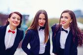 Elegant ladies in black suits outdoors — Stock Photo