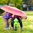 Two happy sisters playing in autumn park — Stock Photo #56507503