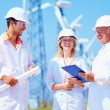 Group of engineers on wind power station — Stock Photo #57695833
