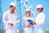 Group of engineers on wind power station — Stock Photo