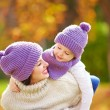 Happy mother and son playing in autumn park — Stock Photo #57842053