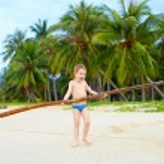 Happy boy enjoys life on tropical island — Stock Photo #60710157