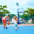 Father and son playing basketball on sport ground — Stock Photo #61403899