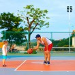 Father and son playing basketball on sport ground — Stock Photo #61403901