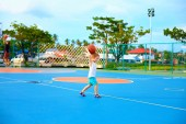 Young boy throwing ball, playing basketball on playground — Stock Photo