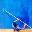 Young adult man, personnel cleaning the pool from leaves — Stock Photo #64666227