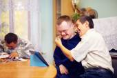 Happy friends with disability socializing through internet — Stock Photo