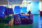 Boy sleeps on seats during exhausting journey on ferry boat — Stock Photo