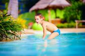 Cute wet kid, boy enjoying vacation in tropical pool — Stock Photo
