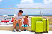 Family waiting for boarding in international airport, summer vacation — Stockfoto