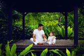 Father teaches son to find inner balance — Stock Photo
